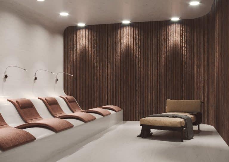 Odpočívárna s křesly a lampičkami, dřevěný dekorativní panel na zdi, bodová světla