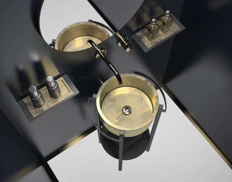 zlaté umyvadlo na černé kovové konzoli, kulaté zrcadlo, zlatá baterie ze zdi, černá stěna, bílá dlažba