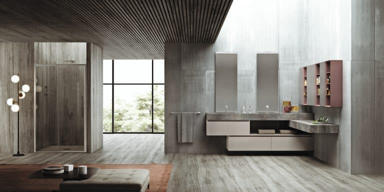 šedá koupelna s obkladem imitace betonu a dlažbou imitace dřeva, sprchový kout v nice