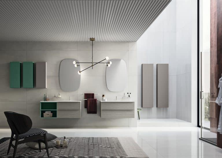 šedá koupelna s šedým dřevěným nábytkem, zelené skříňky, černobílý koberec