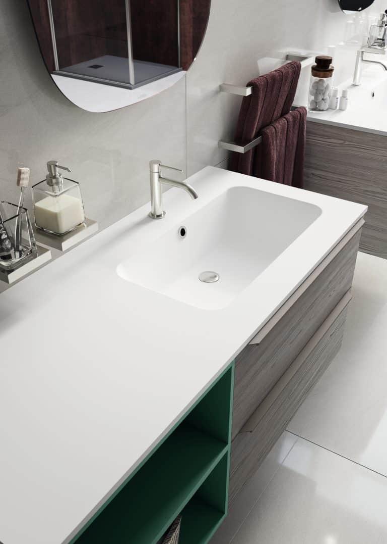 Integrované umyvadlo do bílé desky, dřevěná zelená skříňka pod umyvadlo