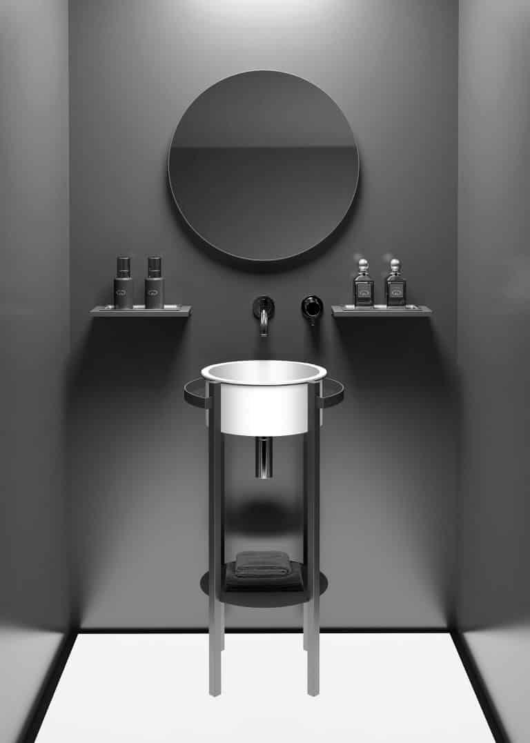 Kulaté umyvadlo s černou konzolí na postavení, černá stěrka na zdi, kulaté černé zrcadlo